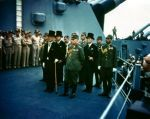Japanese delegation stands before the Allies on the Missouri's 'veranda deck.
