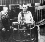 Major General Jonathan M. (Skinny) Wainwright at the microphone of radio station KZRH in Manila, ordering that US and Filipino troops in all the Philippine Islands lay down their arms and surrender to the nearest Japanese garrison. Note the Japanese interpreter listening to Wainwright's right.