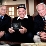 Terry Miller (left), Executive Director of the Tin Can Sailors Association (TCS), presents Lifetime Achievement Award to former destroyerman and Academy Award winner, the late Ernest Borgnine (center), at his home with TCS member John Gobbell (right) looking on.
