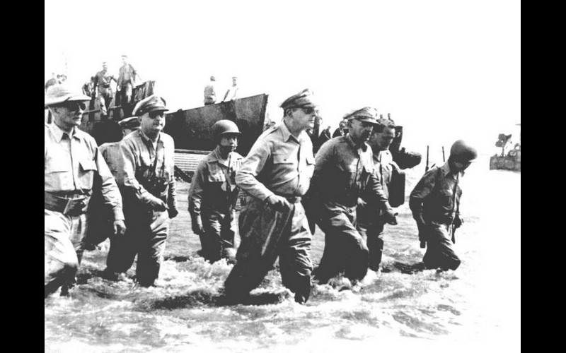 General MacArthur wades ashore with his entourage on A-Day