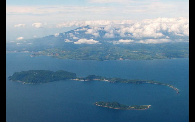 Enroute - they flew over Corregidor Island at the entrance to Manila Bay. Note Bataan Peninsula in background.