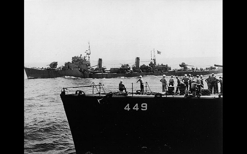 Japanese destroyer - note depressed guns - leads US Fleet into Tokay Bay - USS Nicholas (DD 449) in Foreground