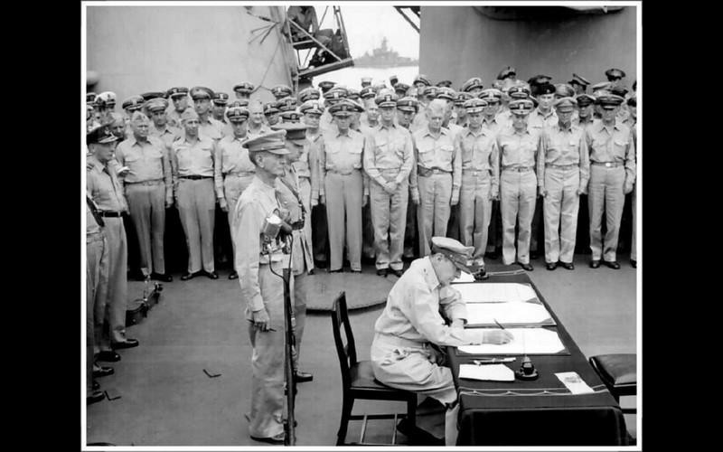 General MacArthur signs as Supreme Allied Commander (SCAP)