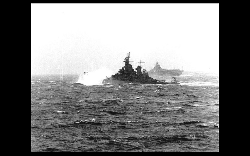 With Admiral Halsey embarked, the USS New Jersey (BB 62) pounds her way north to intercept Ozawa