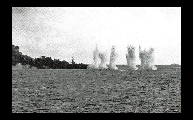 Samar - USS Gambier Bay (CVE 73), one of TAFFY 3's six escort carriers under fire by a cruiser far right - later sunk