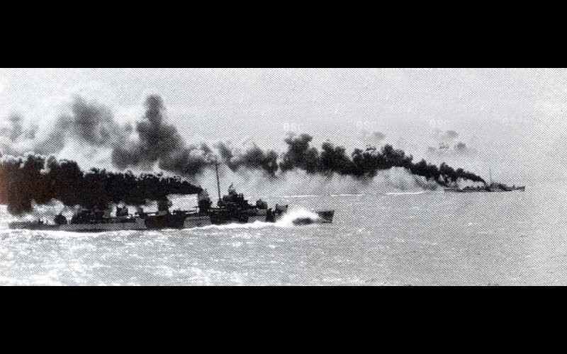 Samar - USS Heermann (DD 532), foreground, and USS John C. Butler (DE 339) make smoke as they charge toward Kurita's ships