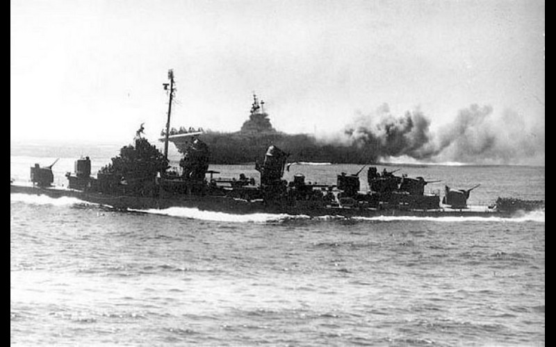Crossing the carrier's bow_ always a risky maneuver espcially in combat. USS Bush (DD 529)- USS Intrepid (CV 11)