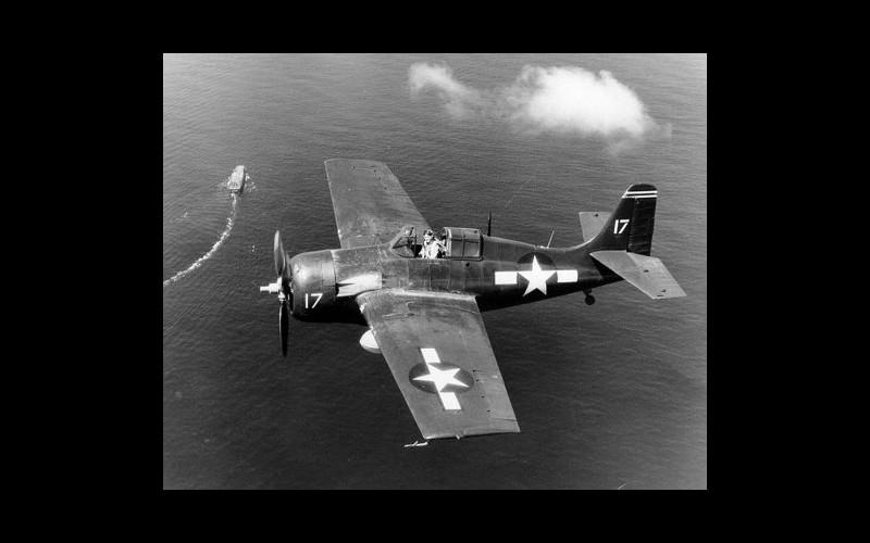 FM2 Wildcat over USS Santee (CVE 29)