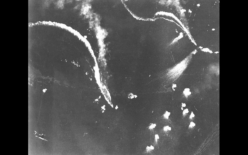 Cape Engaño: Fleet carrier and Pearl Harbor veteran IJN Zuikaku (Ozawa's flagship) under attack and later sunk by aircraft from Halsey's carriers. Note dive bomber attacking at lower left.
