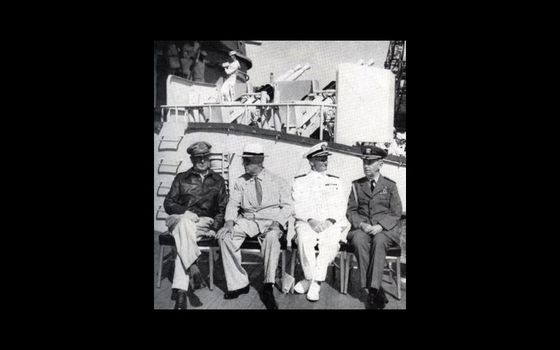 "General Douglas A. MacArthur, President Franklin D. Roosevelt, Admiral Chester W. Nimitz, and Admiral William D. Leahy (FDR""s chief of Staff), aboard USS Baltimore (CA 68) in Pearl Harbor"