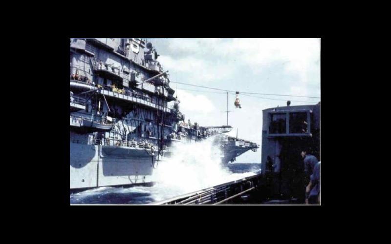Alongside USS Hancock (CVA 19): Personnel transfer at sea to Tingey (DD 539) via boatswain's chair
