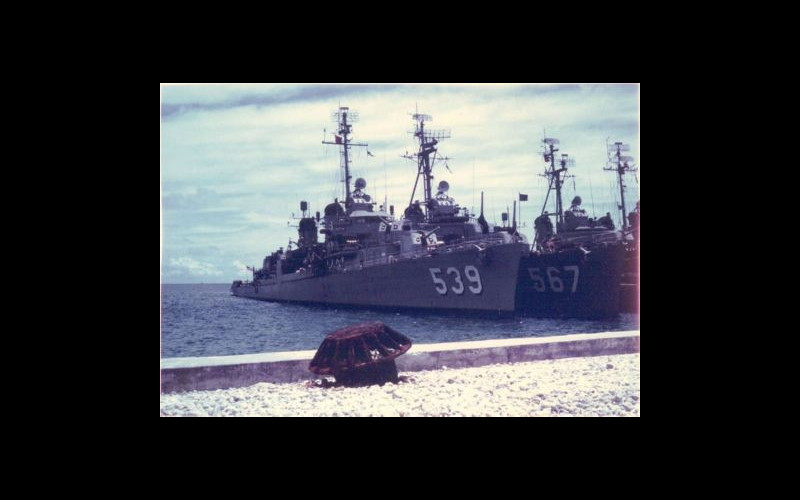 USS Tingey (DD 539), a typical Fletcher class destroyer, re-fuels at Midway Island in 1962. USS Watts (DD 567) is inboard. (Photo by John Samuelson)